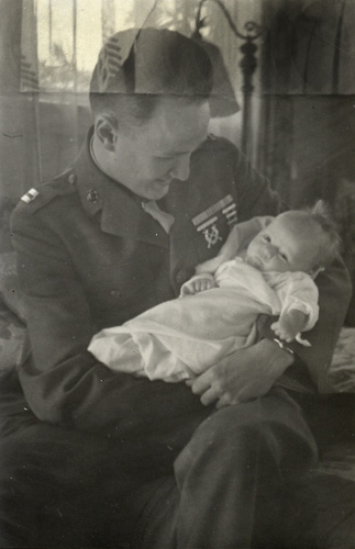 Jeff with his new baby daughter Christy, in 1943.