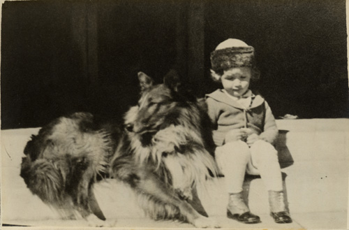 Young Jeff on the steps of the Hoover Street house with the family collie, Napoleon.