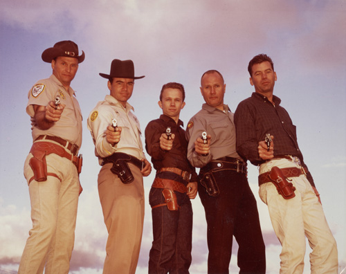 Five of the top six competitors in the early days of practical shooting. From left to right: Ray Chapman, Elden Carl, Thell Reed, Jeff Cooper, Jack Weaver. Missing is John Plahn. Jeff dislikes this picture because they are all violating two of the safety