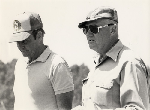 Jeff and Ray Chapman chat at the I.P.S.C. shoot in South Africa before taking off to go buffalo hunting in Rhodesia. 1979