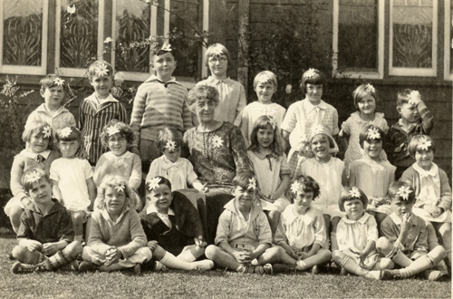 Jeff (standing second from left in last row) in elementary school at The School of the Little Green Trees. Even at that age, he hated those flowers!