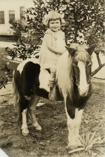 Jane Ellen enjoying a pony ride.