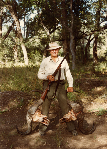 Jeff and 'Baby 'in Africa with the skulls of two buffalo. 2 Shots, 2 Seconds, 2 Buff. Taken 10 May 1990 on Jeff's 70th birthday.